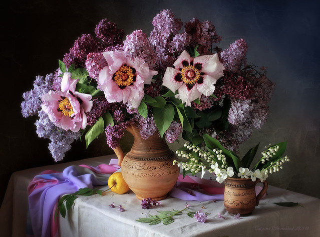 With a bouquet of lilacs and peonies
