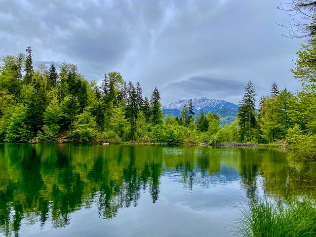 Lake Pfrillsee with view of Zahmer Kaiser mountain range in Tyrol, Austria