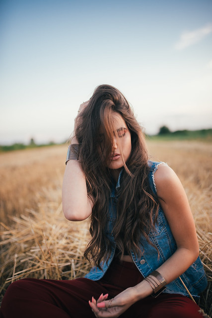 A depressed girl relaxes in the fields.