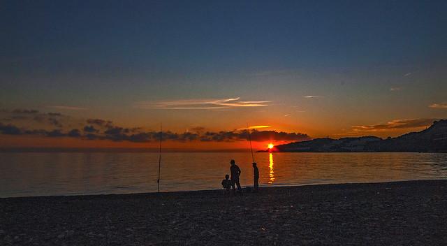 Fishermen in the evening sun