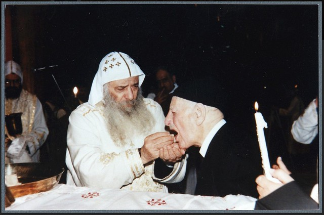 Ragheb Moftah taking Holy Communion with His Holiness Pope Shenouda III  2001