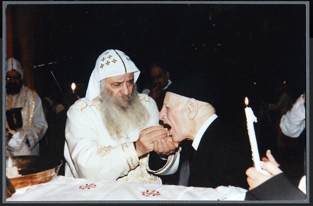 Ragheb Moftah taking Holy Communion with His Holiness Pope Shenouda III  2001 - 2