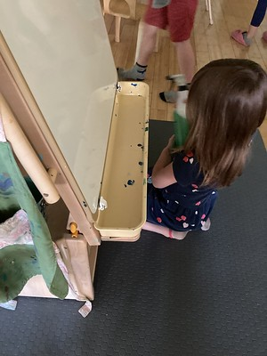 scrubbing the easel