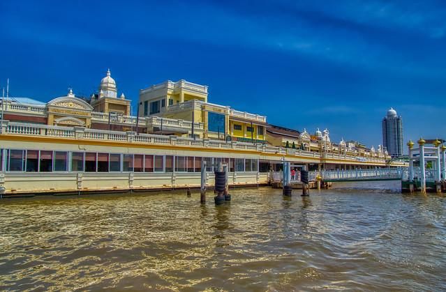 Yodpiman pier and Riverwalk mall by the Chao Phraya river in Bangkok, Thailand