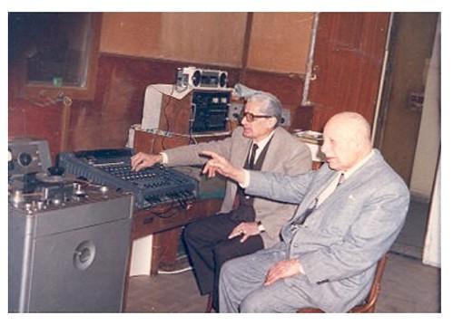 Ragheb Moftah listening to the rendition of the Choir with sound engineer Salib Bastawros ca. 1990s