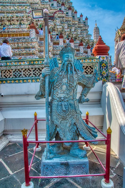 Guardian statue at Wat Arun, the Temple of Dawn, by the Chao Phraya river in Bangkok, Thailand