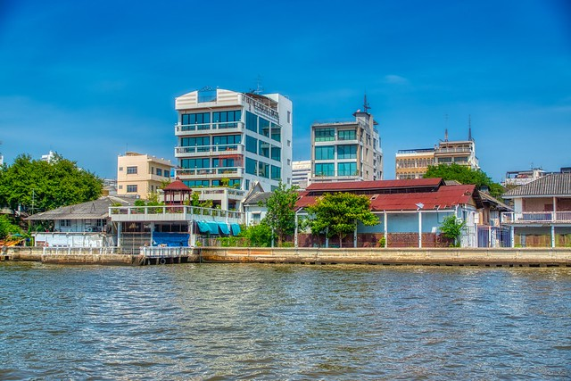 Houses by the Chao Phraya river in Bangkok, Thailand