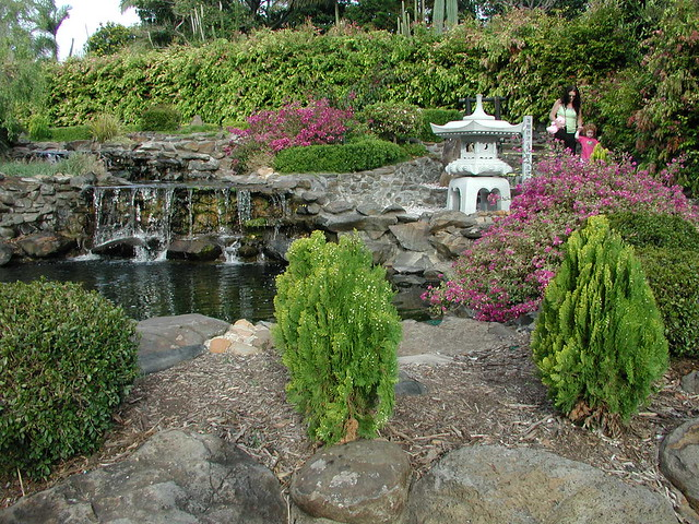 Spirit  House and pond with waterfall in the garden