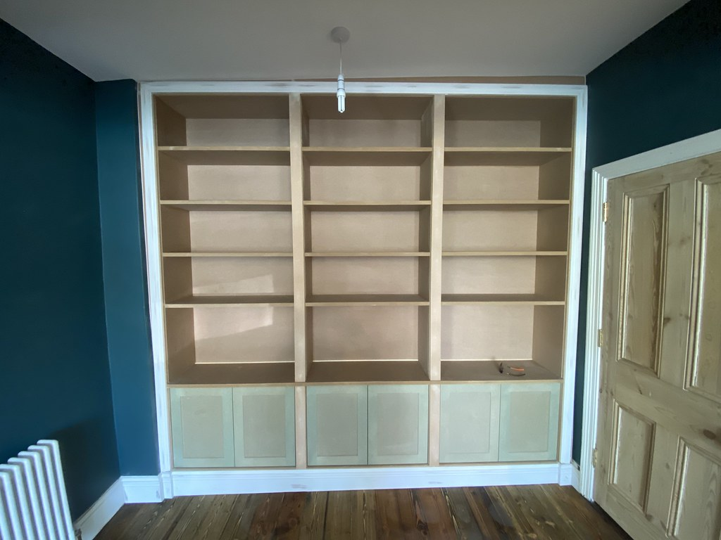 Bespoke bookcase with lower cabinet section.
