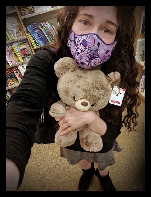 hugging a teddy bear🐻