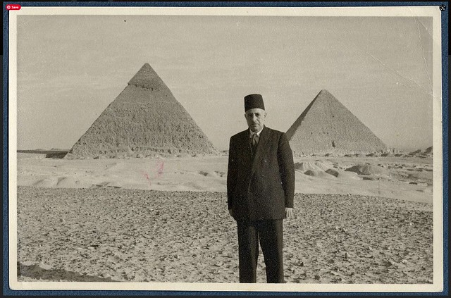 Ragheb Moftah standing in front of pyramids in Giza, ca. 1940s