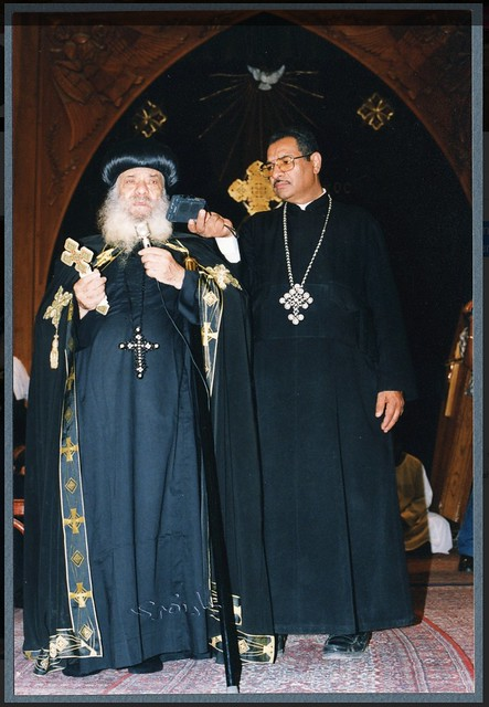 His Holiness Pope Shenouda III chanting into tape recorder at Ragheb Moftah funeral