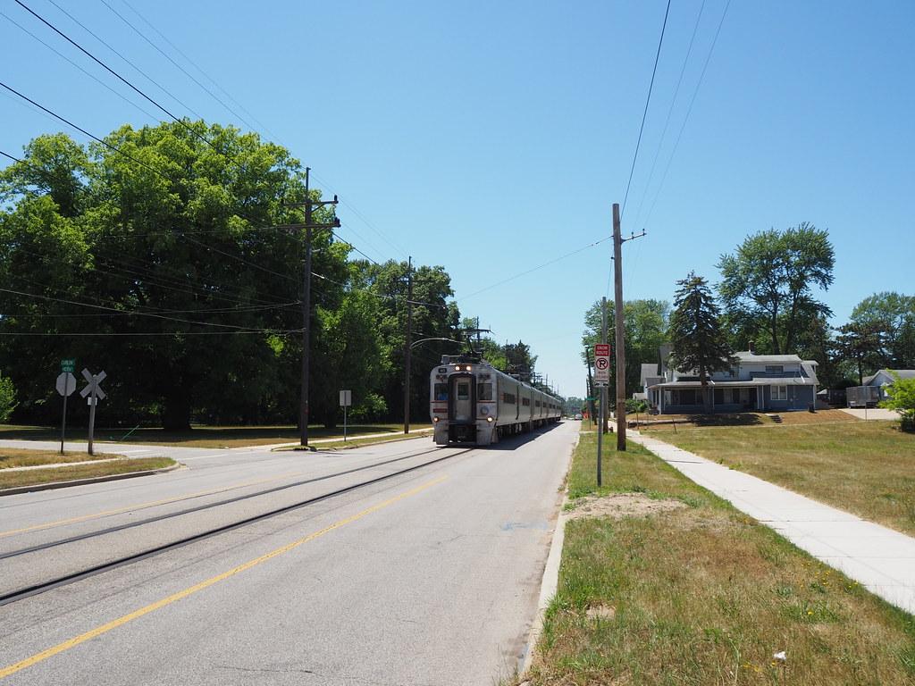 South Shore Line train on 10th Street passing Carlon Ct