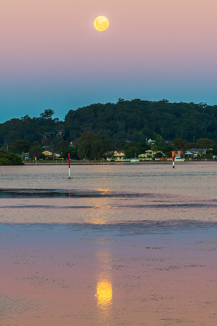 Nearly a full moon, sunset waterscape