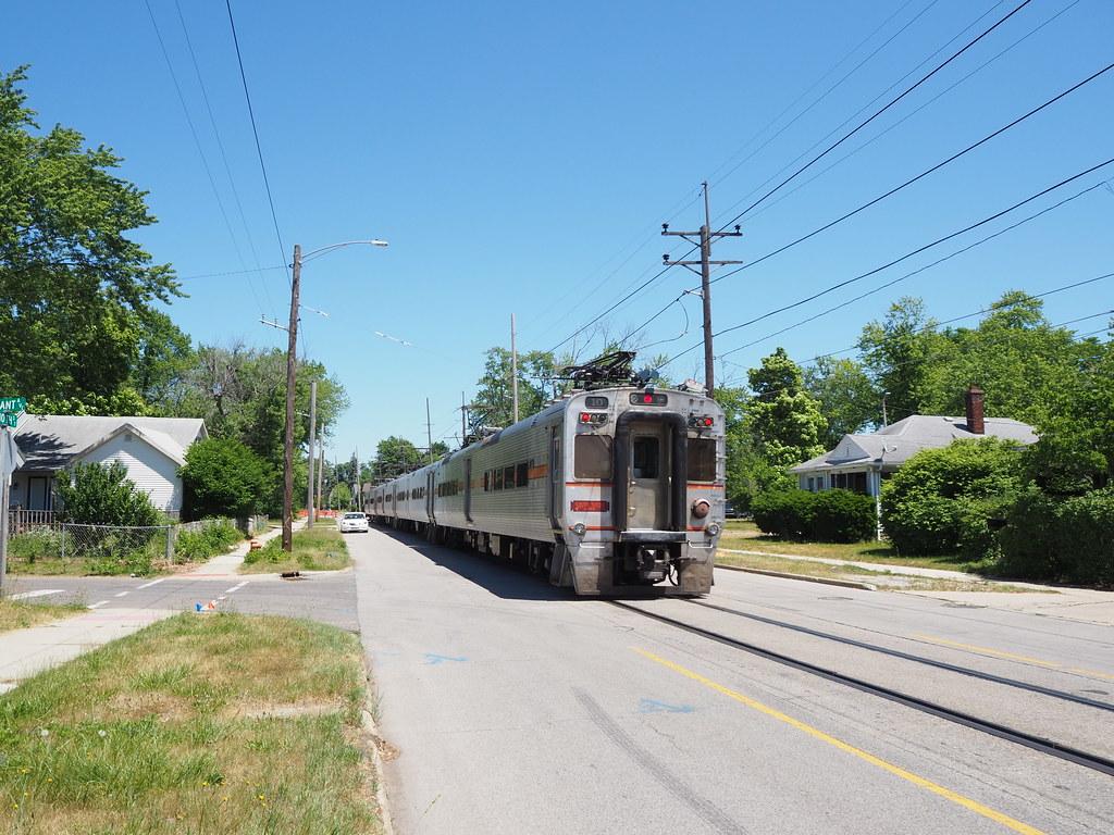 South Shore Line train passing Carlon Court on 10th Street