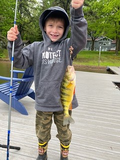 Six-year-old Stephen Richter certainly is enjoying his time at Deep Creek Lake and holds up a large yellow perch he caught. Photo by Steve Richter Jr.
