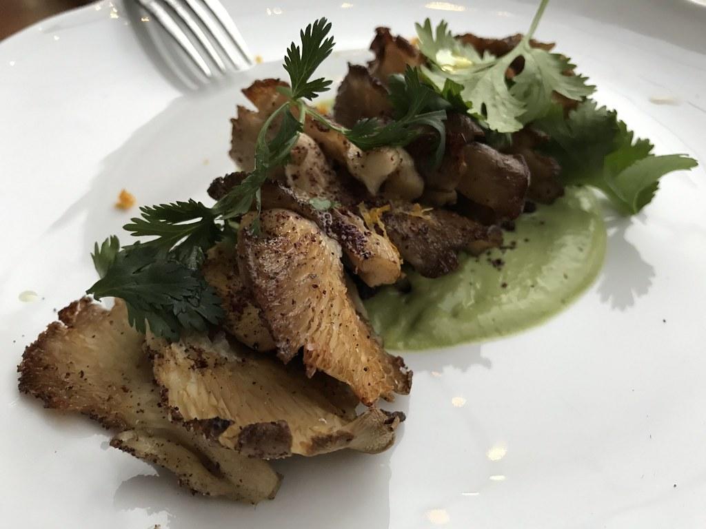 oyster mushroom kebab on lovage / avocado purée