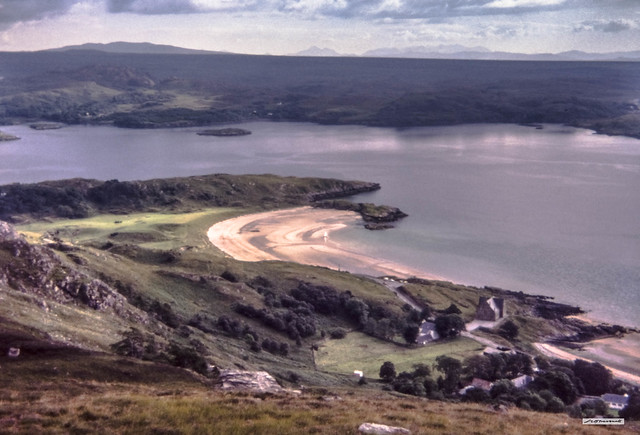 At 120 metres above Gairloch Hotel, a view over Gairloch Beach, Red Point Peninsula and part of the Applecross Peninsula to the Cuillins of Skye.