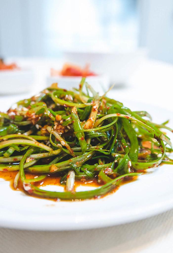 A side shot of Korean green onion salad.