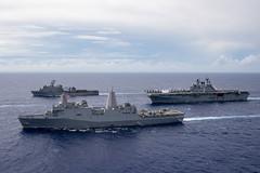 The America Amphibious Ready Group  sails in formation in the Philippine Sea, June 13. (U.S. Navy/MC3 Jomark A. Almazan)