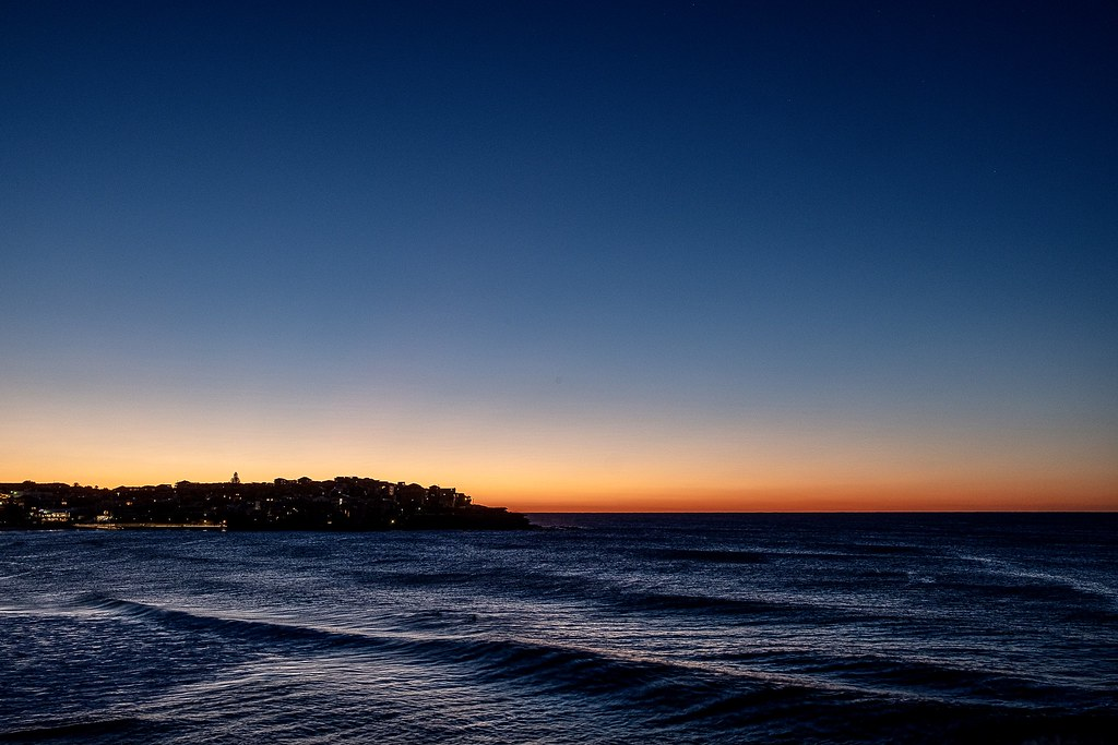 Standing on the southern head of Bondi with the beach just off to the left, the breeze is cool, the sunrise is impending and the company is nil. What a great start to a Sydney winter's day.