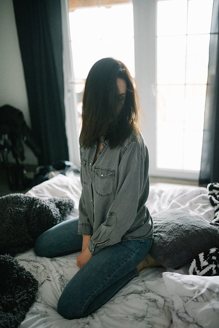 Lonely woman sitting on the bed. Morning concept.