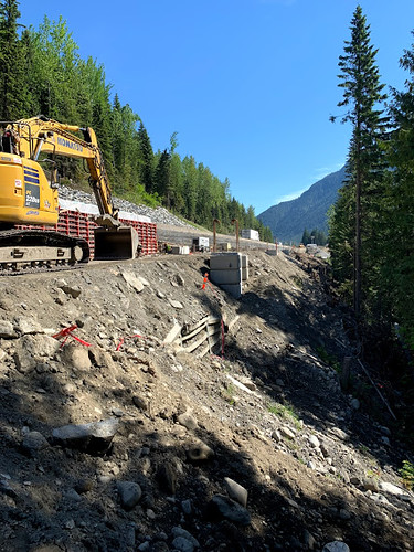 Excavator at work on site of the Illecillewaet Brake Check and Four-laning expansion project