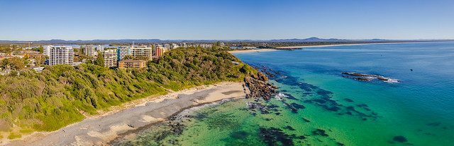 Pebbly Beach Aerial Morning Shorescape Panorama with High Rises