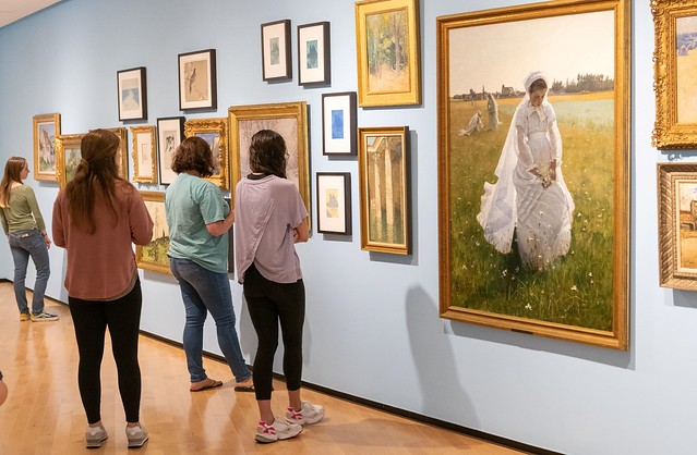 Students look at art at the Jule Collins Smith Museum of Fine Art.