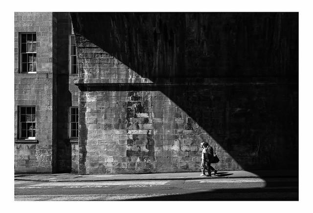 Couple Leaving Shadow Under Bridge   Edinburgh