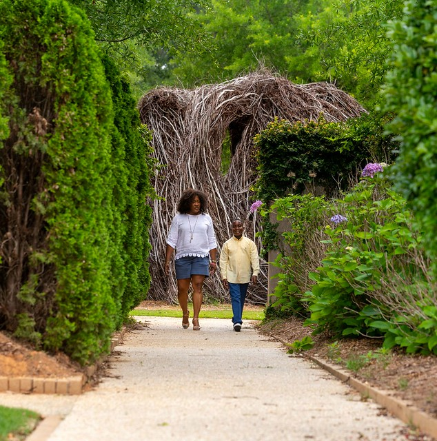 People walk on a path at the Jule Collins Smith Museum of Fine Art.