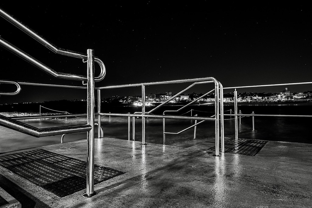 At the northern end of Sydney's Bondi Beach there are two ocean pools, one is man-made, the other mostly natural. These are the railings between them with the natural pool in shot…. It was cold, and I got a little wet.