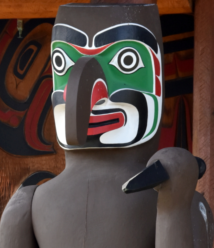 GREETER TOTEM IN FRONT OF THE CULTURAL MESEUM BUILDING, ( BUT WITH A DAGGER!)    ALERT BAY,  NORTHERN VANCOUVER ISLAND,  BC.