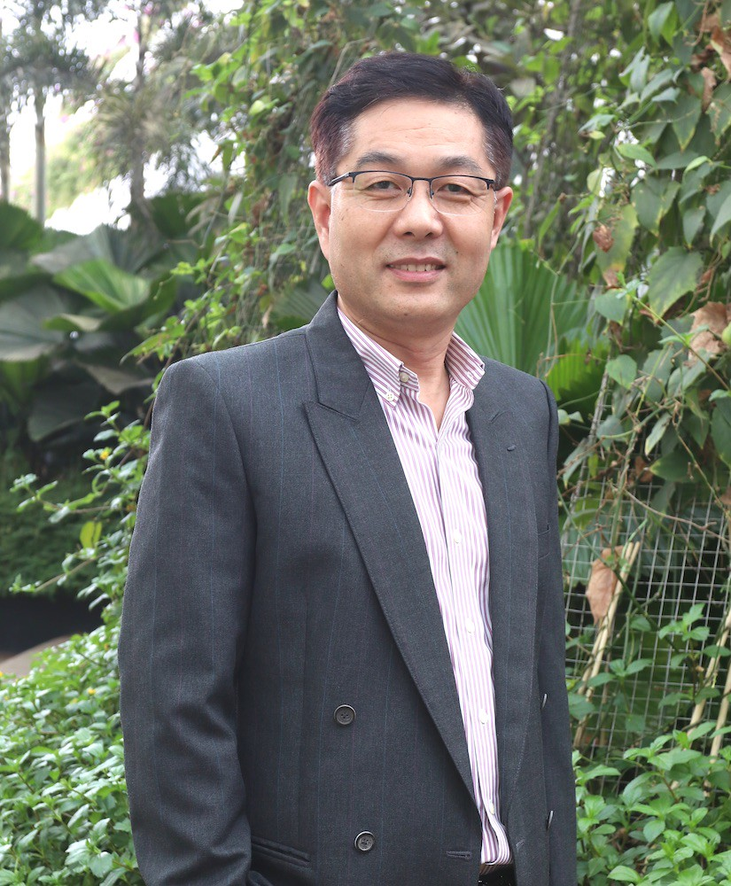 Headshot of  professor Cuntai Guan