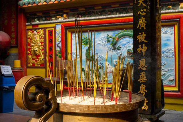 Burning Incense Sticks in a Large Pot with Sand inside the Chinese On Lang Pagoda in Chinatown in Ho Chi Minh City, Vietnam
