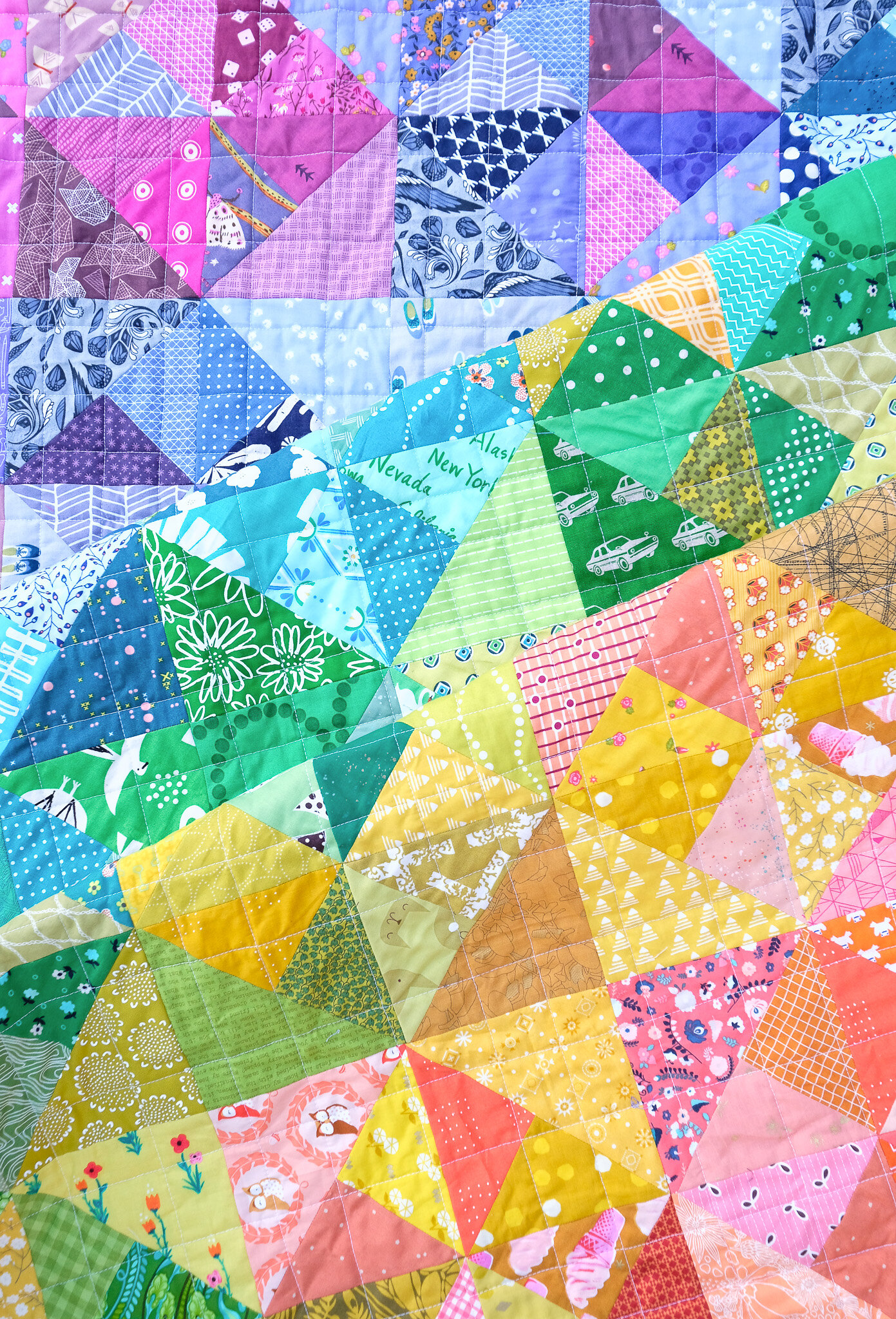 A Rainbow Cleo Quilt - Kitchen Table Quilting