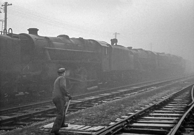 In the last month of steam operation at Carlisle Kingmoor MPD a railwayman switches the points to allow yet more condemned locomotives to be shunted into the area where redundant locomotives were stored prior to being sent to the scrapyard. (EXPLORED)