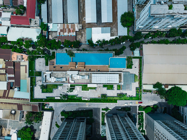 Top View Drone Photo of the Rooftop of GoldView Apartment Building with Small Garden and Swimming Pool in District 4 in Saigon, Vietnam