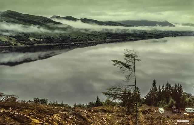 Loch Carron village is revealed by recent forest clearance in this early morning view of cloud straddling this West Coast sea-loch, Wester Ross, Scotland.