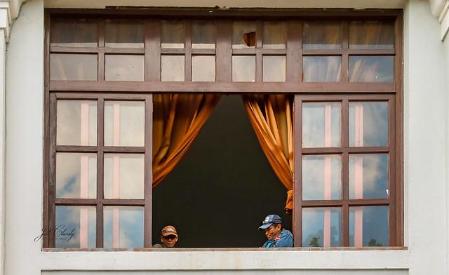 Armchair Traveling - Two Men in a Window,  León, Nicaragua