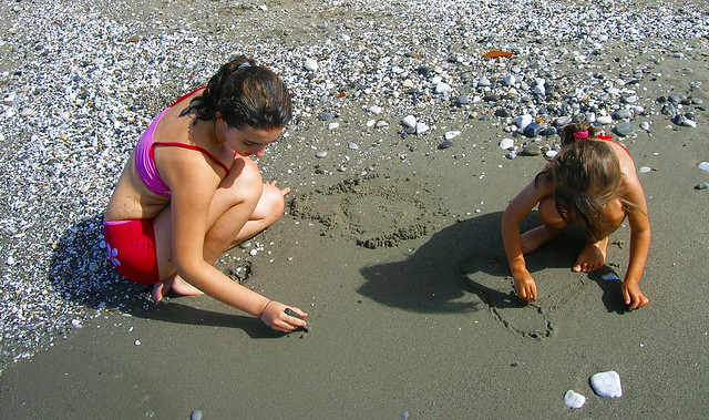 Girls Drawing in the Sand.