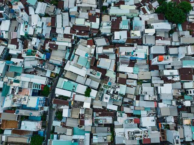 Top View Drone Photo of Buildings, Alleys and Trees in a Local Residential Area in District 4 in Ho Chi Minh City, Vietnam