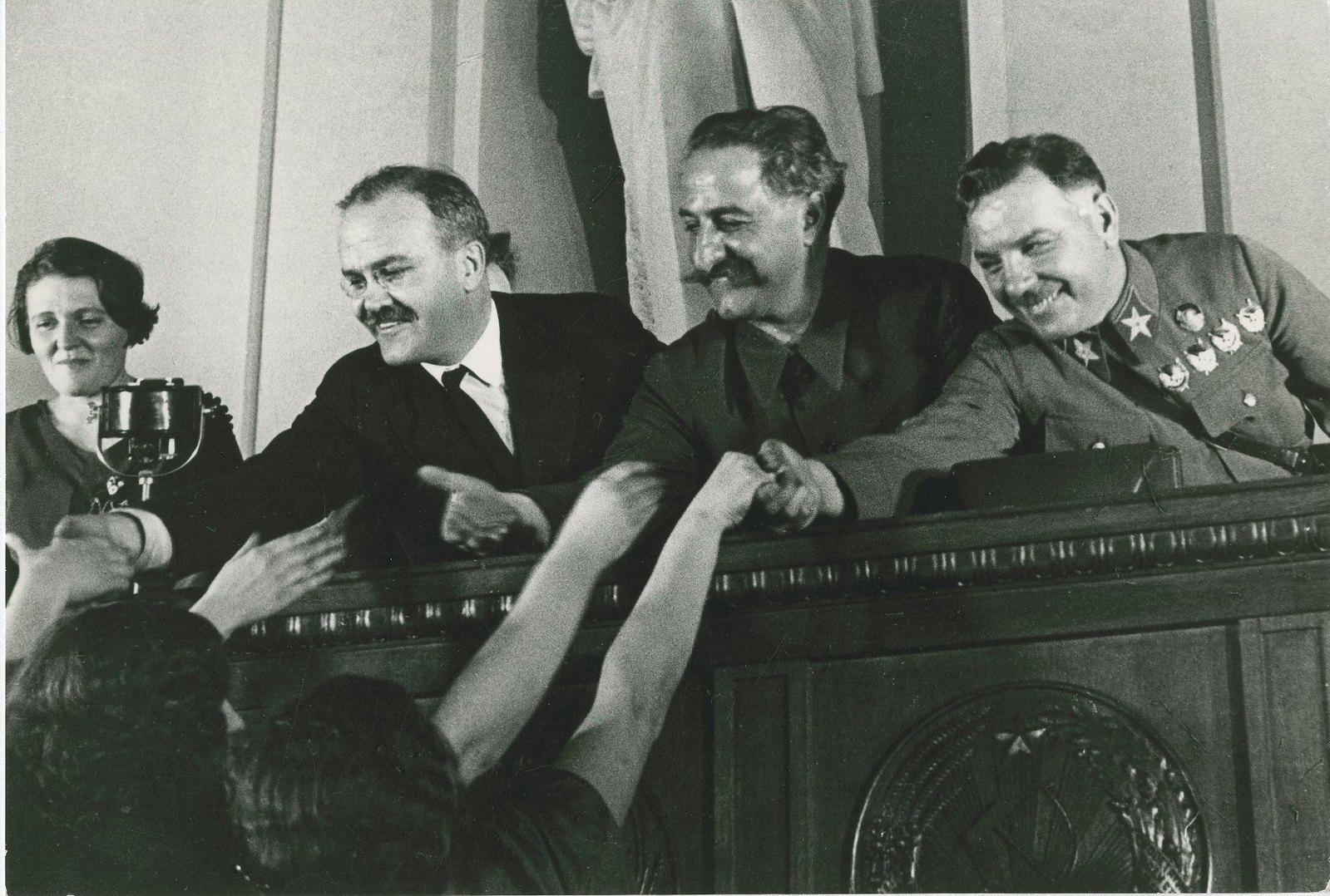 1936. Серго Орджоникидзе, К.Е. Ворошилов и В.М. Молотов на совещании жен командиров в Кремле