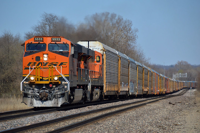No shortage of autos here, a rack train polishes the rails at Fort Madison Iowa