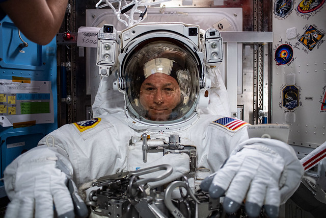 Astronaut Shane Kimbrough is suited up preparing for a spacewalk