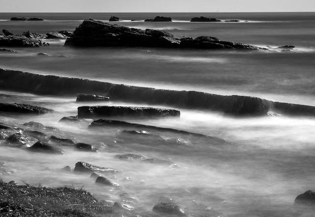 Water against rocks, Anstruther, Fife, Scotland, UK B&W