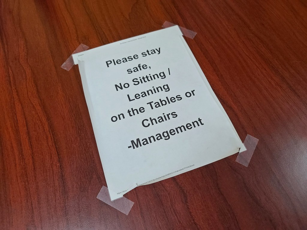 No sitting or leaning on the tables or chairs