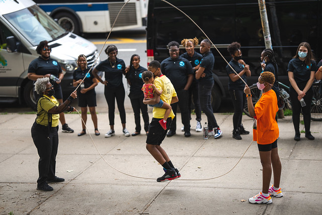 Double Dutch While Holding a Baby