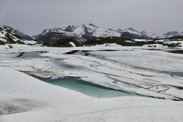 Grimsel Pass Switzerland with frozen lake Totensee