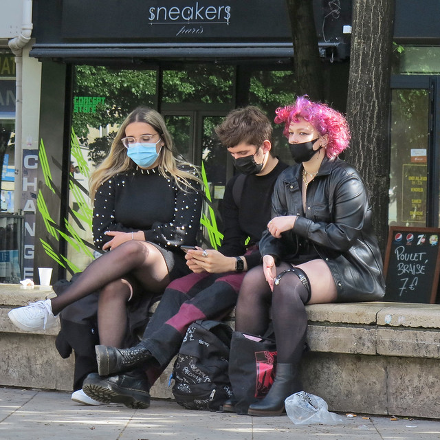 An hour later two of the three girls who were conversing with the younger boy are still sitting in the same place